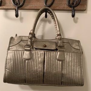 ALDO  Silver-Gold purse in good condition